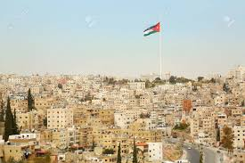 Flags And Flagpoles Amman City View With Big Jordan Flag And Flagpole Stock Photo