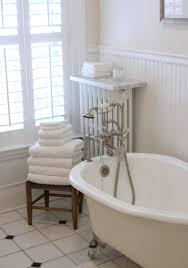 white bathroom with tile and beadboard paneling bathroom tile