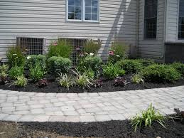 garden design with landscaping ideas for a river rock vs mulch