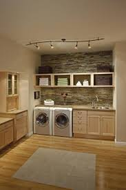simple tasty laundry room area wit rustic wood and stone elements