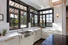 white kitchen cabinets with window trim black windows with black trim creates a bold focal point pella
