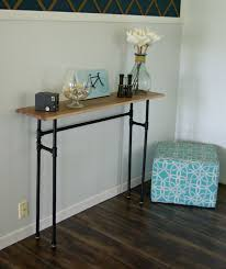 small and narrow rustic console table with black galvanized pipes