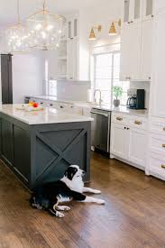 two tone kitchen cabinets and island trend we re loving two toned kitchens farmhouse living