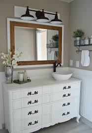 gorgeous bathroom lighting over mirror and over bathroom cabinet