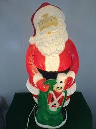 8 foot santa claus on a fishing boat