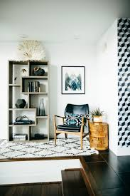 hanging picture height how high to hang pictures on the wall popsugar smart living