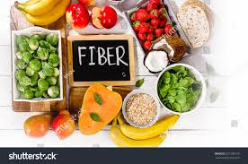 high fiber foods on wooden background stock photo 521209120