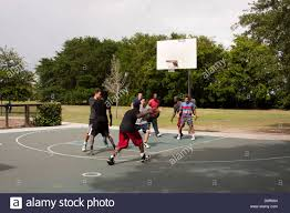 group of guys playing basketball stock photo royalty free image