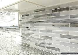 light grey brick tiles grey kitchen backsplash gray white some brown tones modern subway