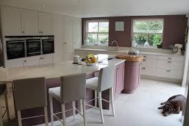 White Modern German Kitchen With White Corian Work Surfaces