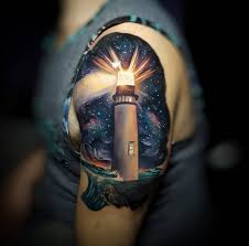 arty lighthouse with space background best tattoo design ideas