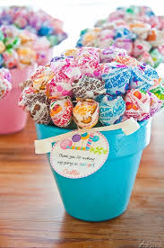 inexpensive party favors lollipop bouquets nestled in painted pots cheap and