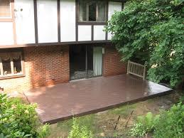 exterior design rosybrown azek decking and brick wall ideas