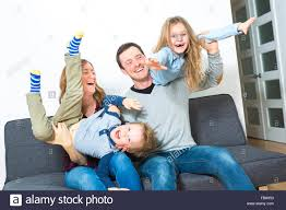 nice family sit on the livingroom sofa stock photo royalty free