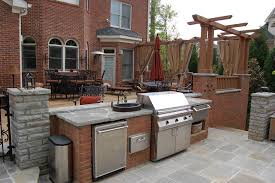 patio with outdoor kitchen by charles hodges ltd gardens