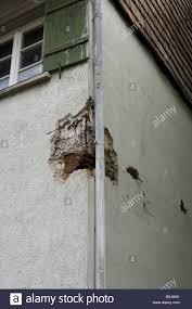 house outside detail corner damages broken old old stock photo