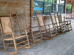 Wooden Rocking Chairs by Row Of Wooden Rocking Chairs On Porch Stock Photo Picture And
