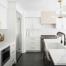 kitchen with black island and white cabinets black island with white cabinets design ideas
