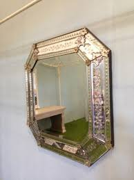 large octagonal venetian wall mirror with decorative detailed