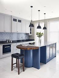 white kitchen cabinets with blue island a blue kitchen island with white cabinets is an and