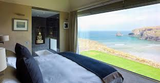 large frameless picture frame structural glass window in a bedroom