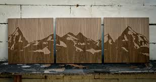 wooden mountain range triptic on behance