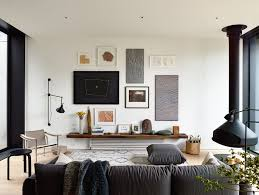 decordots living room suspended fireplace lampe gras gallery wall