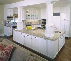 kitchen islands with posts white and open kitchen when you re stuck with beams and columns