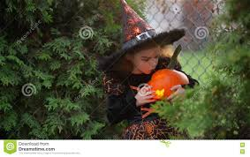halloween background child child little witch on halloween on a background of autumn leaves