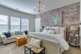 traditional master bedroom with high ceiling u0026 interior brick in