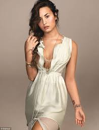 my scars are battle wounds u0027 defiant demi lovato reveals she is