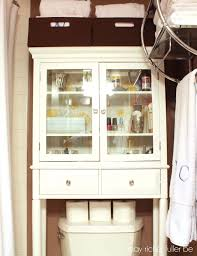 Bathroom Storage Cabinets With Drawers White Wooden Cabinet With Glass Door And Drawers Placed On The