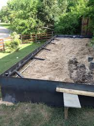 Retaining Wall Garden Bed by How To Install A Steel Plate Retaining Wall Google Search