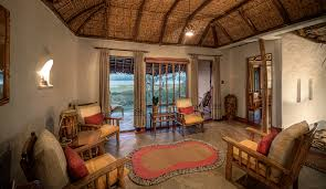Orange Livingroom by Kabini Pool Huts Kabini Living Room