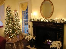 living room black fireplace surrounds mantel with round gold