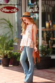 peplum and flared jeans upbeat soles florida style blog