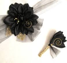 and black corsage dahlia flower with gold corsage and boutonniere