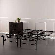 bedroom black iron bed frame with wooden bedside table also white
