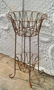 Wrought Iron Wall Planters by European Wrought Iron Trellis Wall Planter Outdoor Spaces