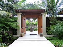 palm tree landscaping exterior tropical with garden statues and