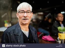 looking with grey hair portrait of senior man with grey hair wearing glasses looking at