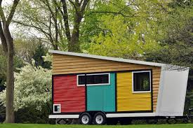 would you live in one of these candy colored tiny homes