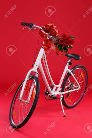 large gift bow white bicycle on a background with a large gift bow and a