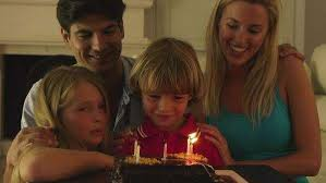 blowing out candles on birthday cake stock video footage