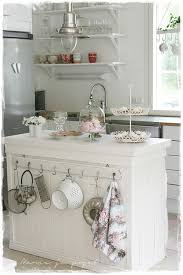 shabby chic kitchen island shabby chic kitchen island with slightly mismatched hooks on one