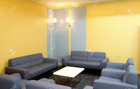 trendy living room sofa chairs and tables all in blue and