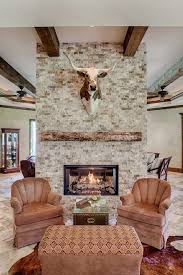 stone gas fireplace mantel living room rustic with open floor plan