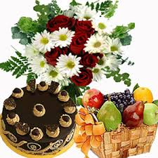 fruits flowers send roses with 1 2 kg chocolate cake and 3kgs fruits basket to india