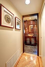 asian inspired powder room with tile accent wall jackson design
