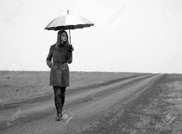 lonely with umbrella at country road photo in old black